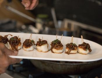 scallops on plate being served at a party
