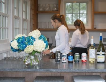 two female staff at an event party at a nantucket vacation rental