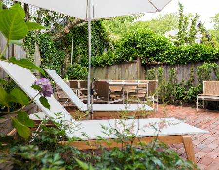 lounge chair in bright green foliage on sundeck at Nantucket vacation rental home