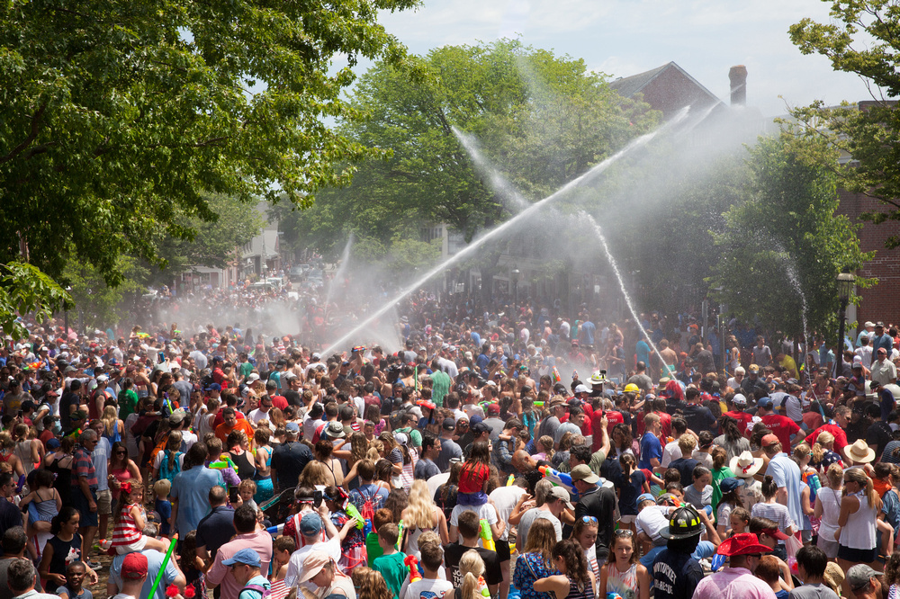 hazlegrove view of tons of people with water hoses shooting water everywhere