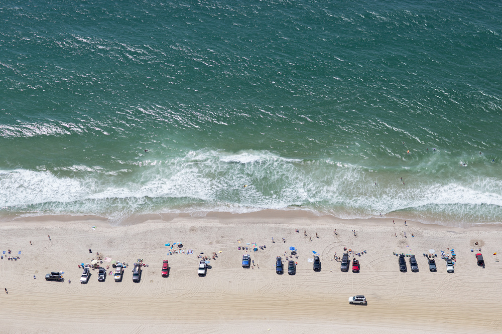 aerial view of nantucket beach with cars parked along the shoreline